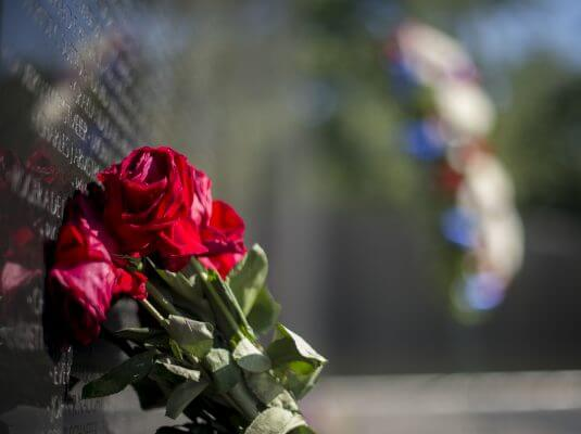 Roses laid against Vietnam Veteran Memorial