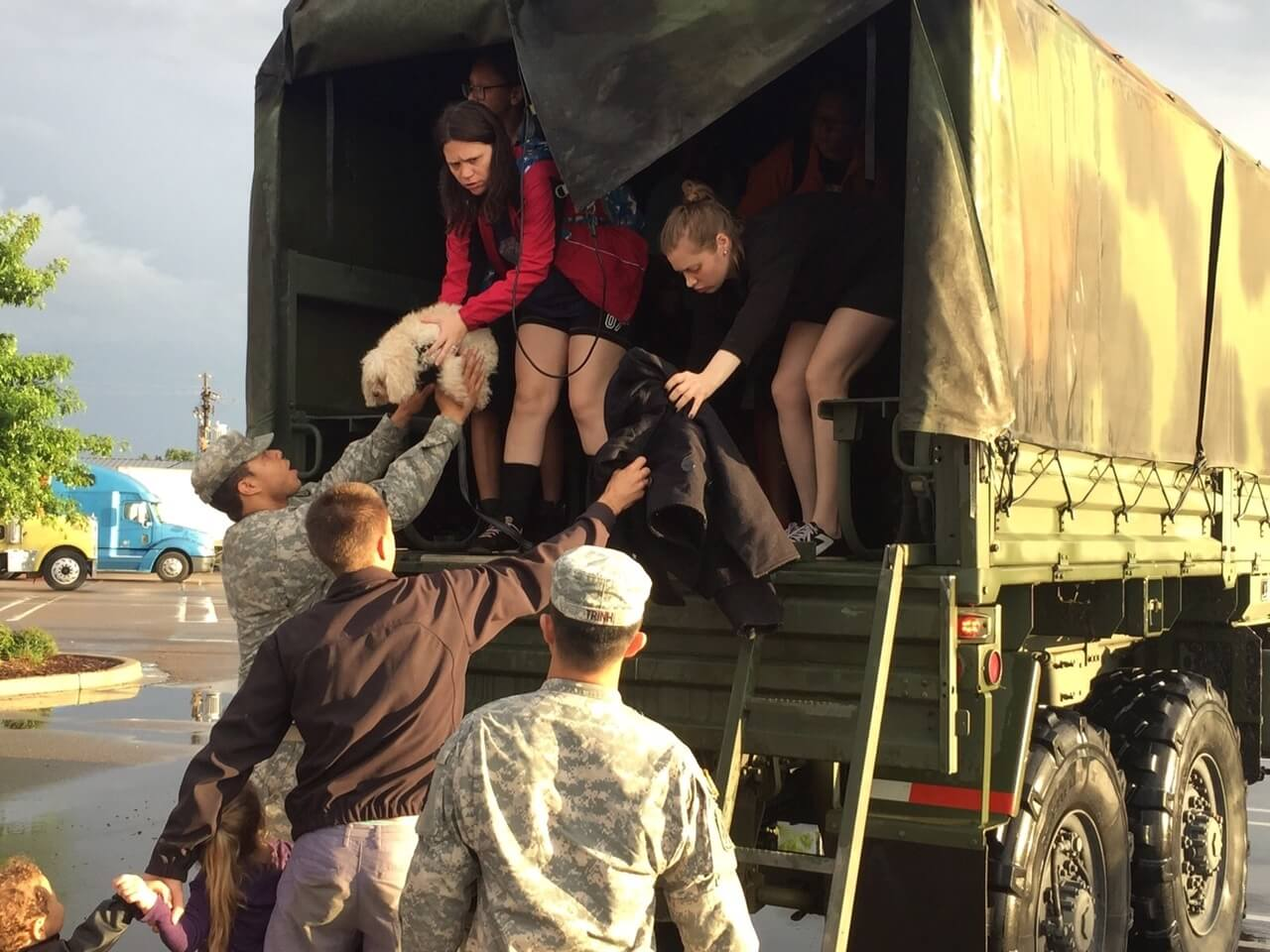Soldiers with the Louisiana National Guard help citizens out of the back of a high-water vehicle on Airline Road in Baton Rouge, Louisiana after being rescued on Millerville, Aug. 14, 2016. The LANG has rescued more than 3,400 people and 400 pets during search and rescue operations since operations began 48 hours ago. (U.S. Army National Guard by 1st Lt. Gomez)